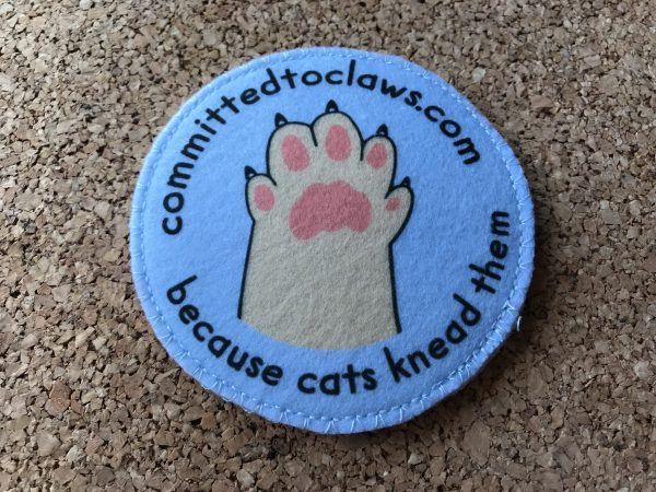 The front of the cat toy with paw logo
