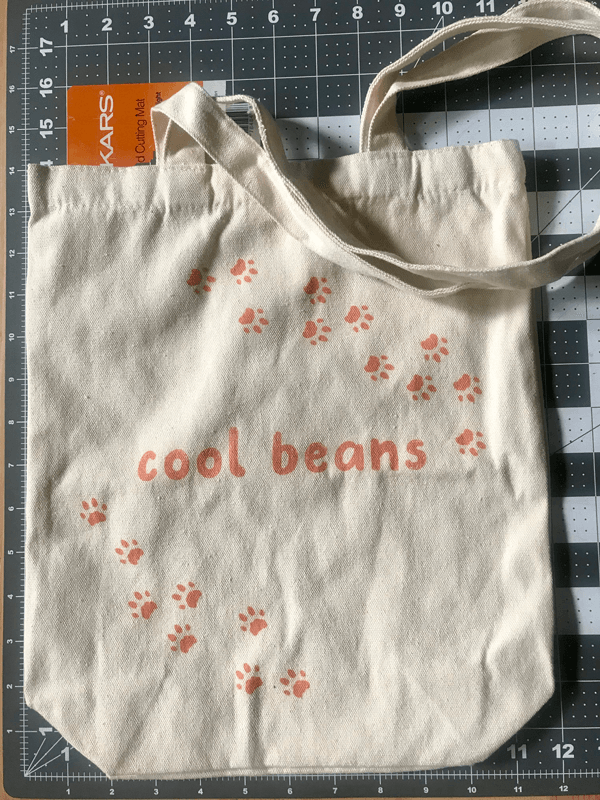 Tote bag on cutting mat to show size on grid.
